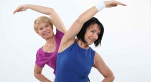 Two older women exercising